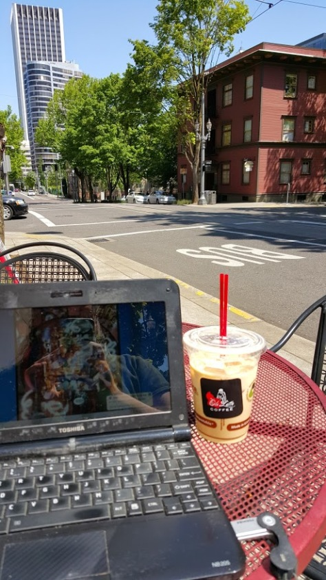 Enjoying the sun and a coffee from my favorite cart for lunch on Friday.